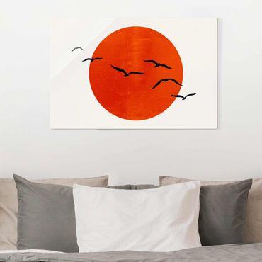 Quadro in vetro - Stormo di uccelli davanti al sole rosso - Orizzontale 2:3