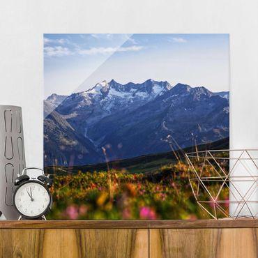 Quadro in vetro - Prato fiorito nelle montagne
