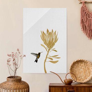 Quadro in vetro - Colibrì e fiore tropicale dorato