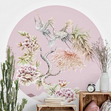 Carta da parati rotonda autoadesiva - Acquerello Cicogne in volo con fiori sul colore rosa