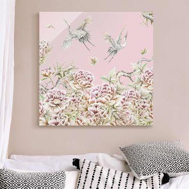 Quadro in vetro - Acquerello di cicogne in volo con rose su rosa