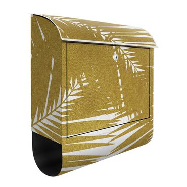 Cassetta postale - Scorcio tra foglie di palme dorate