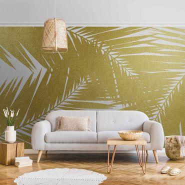 Carta da parati metallizzata - Scorcio tra foglie di palme dorate