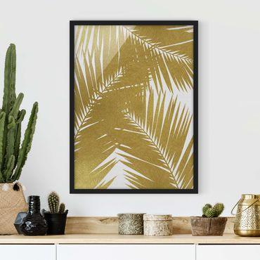 Poster con cornice - Scorcio tra foglie di palme dorate