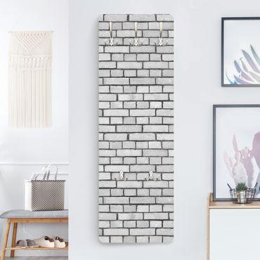 Appendiabiti effetto pietra - Muro di mattoni bianco