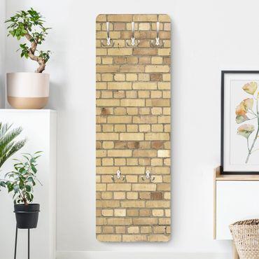 Appendiabiti effetto pietra - Muro in mattoni giallo chiaro