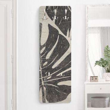 Appendiabiti - Foglie di palma contro grigio chiaro