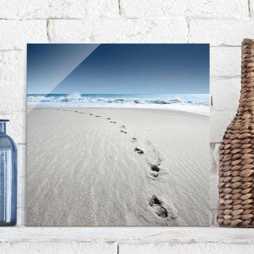 Quadro in vetro - Footprints in the sand - Quadrato 1:1