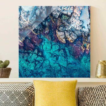 Quadro in vetro - Top View costa rocciosa colorata