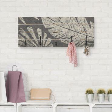 Appendiabiti in legno - Foglie di palma confronti di un grigio scuro