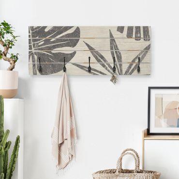 Appendiabiti in legno - Foglie di palma contro un grigio chiaro
